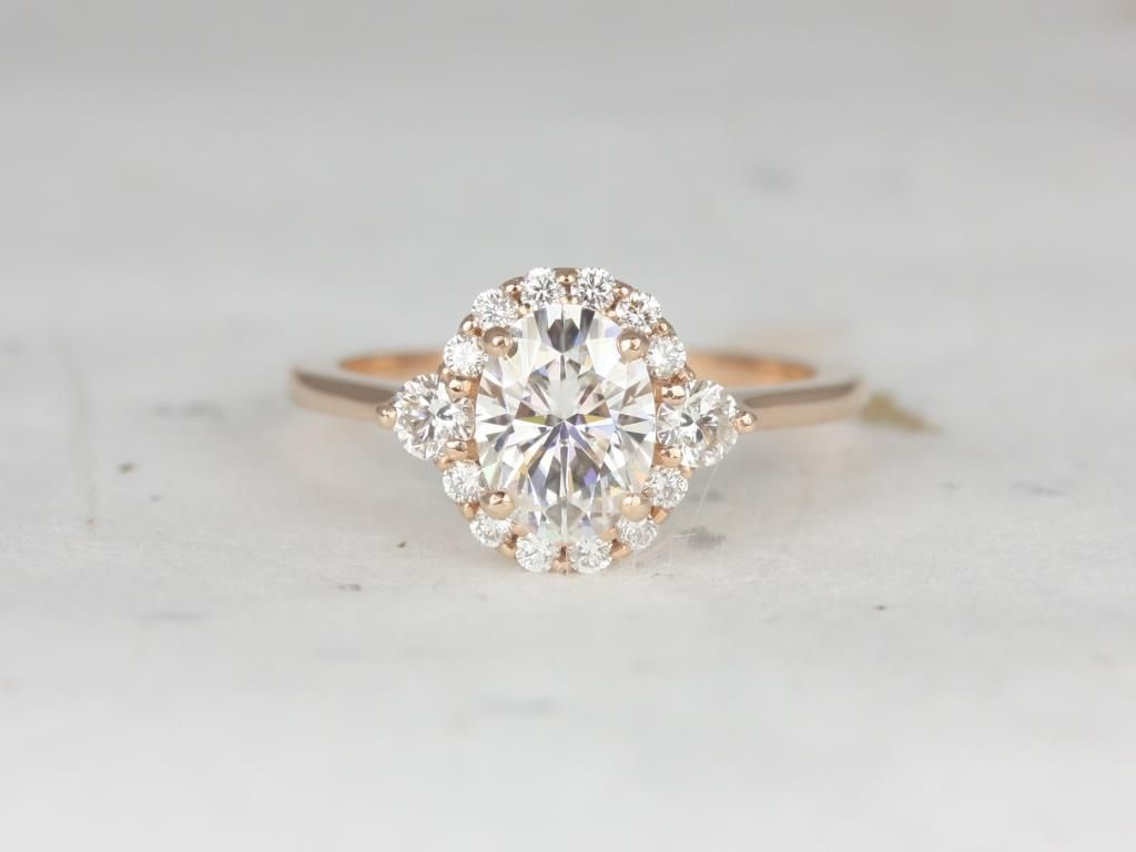 https://www.loveandpromisejewelers.com/media/catalog/product/cache/1b8ff75e92e9e3eb7d814fc024f6d8df/r/o/rosados_box_britney_8x6mm_14kt_rose_gold_oval_forever_one_moissanite_and_diamonds_halo_engagement_ring_3_.jpg