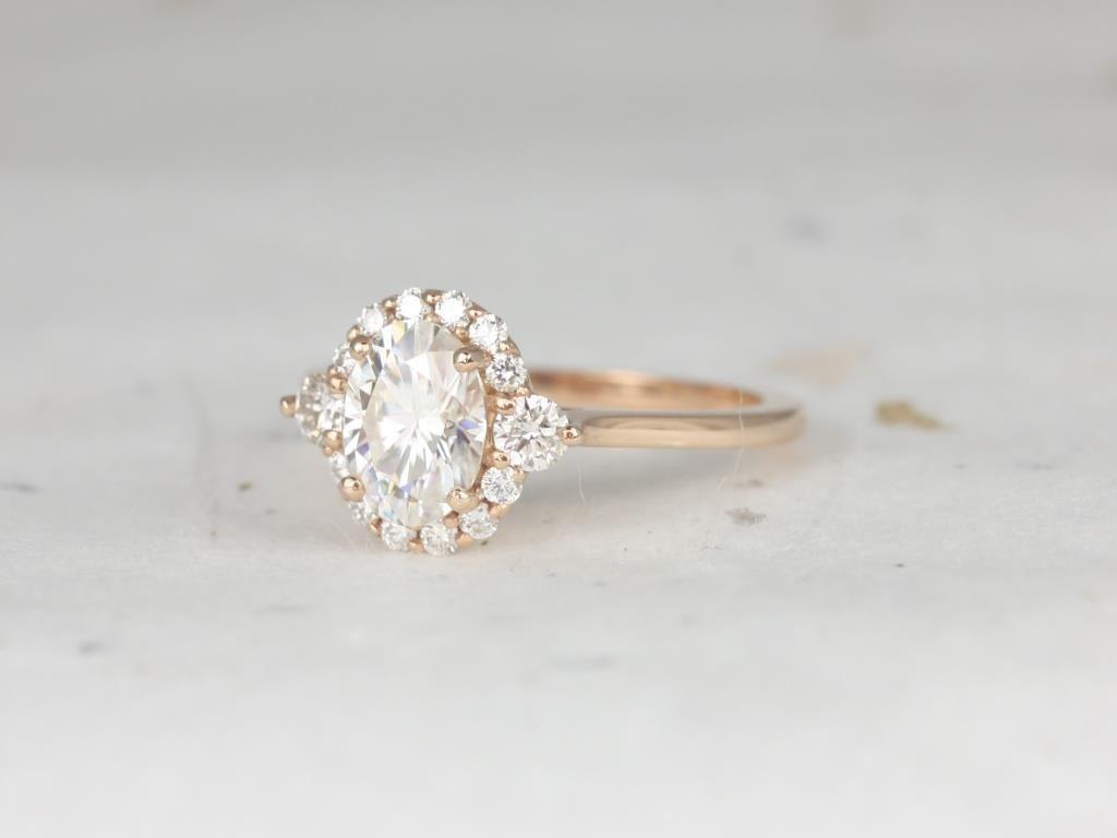 https://www.loveandpromisejewelers.com/media/catalog/product/cache/1b8ff75e92e9e3eb7d814fc024f6d8df/r/o/rosados_box_britney_8x6mm_14kt_rose_gold_oval_forever_one_moissanite_and_diamonds_halo_engagement_ring_4_.jpg
