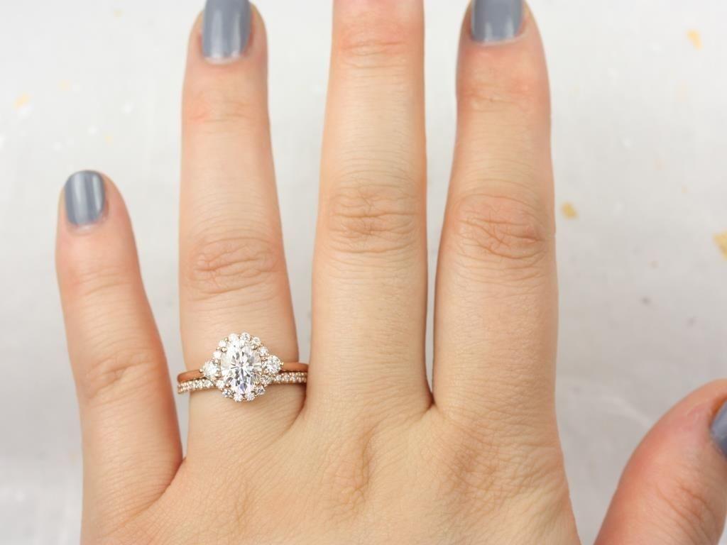 https://www.loveandpromisejewelers.com/media/catalog/product/cache/1b8ff75e92e9e3eb7d814fc024f6d8df/r/o/rosados_box_britney_8x6mm_14kt_rose_gold_oval_forever_one_moissanite_and_diamonds_halo_wedding_set_6__1.jpg