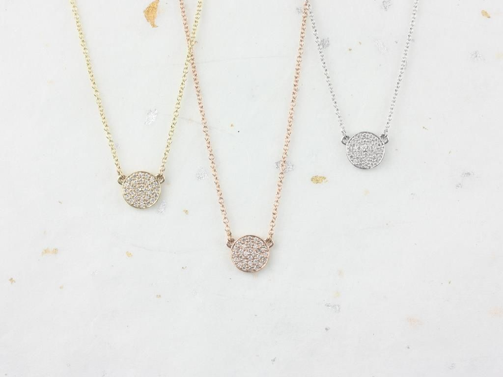 https://www.loveandpromisejewelers.com/media/catalog/product/cache/1b8ff75e92e9e3eb7d814fc024f6d8df/r/o/rosados_box_diskco_7mm_14kt_rose_gold_diamond_pave_floating_disk_necklace_1__2.jpg