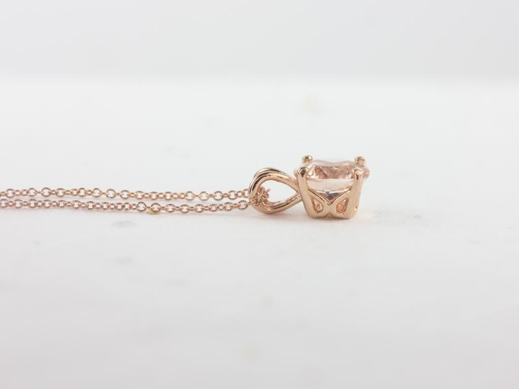 https://www.loveandpromisejewelers.com/media/catalog/product/cache/1b8ff75e92e9e3eb7d814fc024f6d8df/r/o/rosados_box_donna_8mm_14kt_rose_gold_morganite_leaf_gallery_basket_solitaire_necklace_3_.jpg