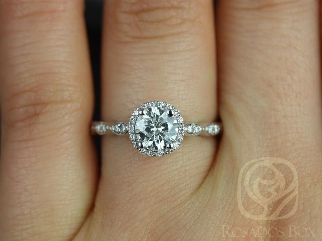 https://www.loveandpromisejewelers.com/media/catalog/product/cache/1b8ff75e92e9e3eb7d814fc024f6d8df/s/a/samantha_6mm_14kt_white_gold_round_fb_moissanite_diamond_without_milgrain_halo_engagement_ring_3wm_1.jpg