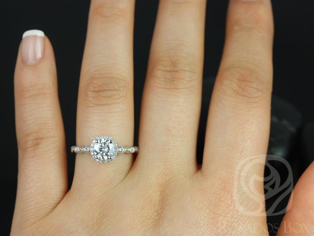 https://www.loveandpromisejewelers.com/media/catalog/product/cache/1b8ff75e92e9e3eb7d814fc024f6d8df/s/a/samantha_6mm_14kt_white_gold_round_fb_moissanite_diamond_without_milgrain_halo_engagement_ring_4wm_1.jpg