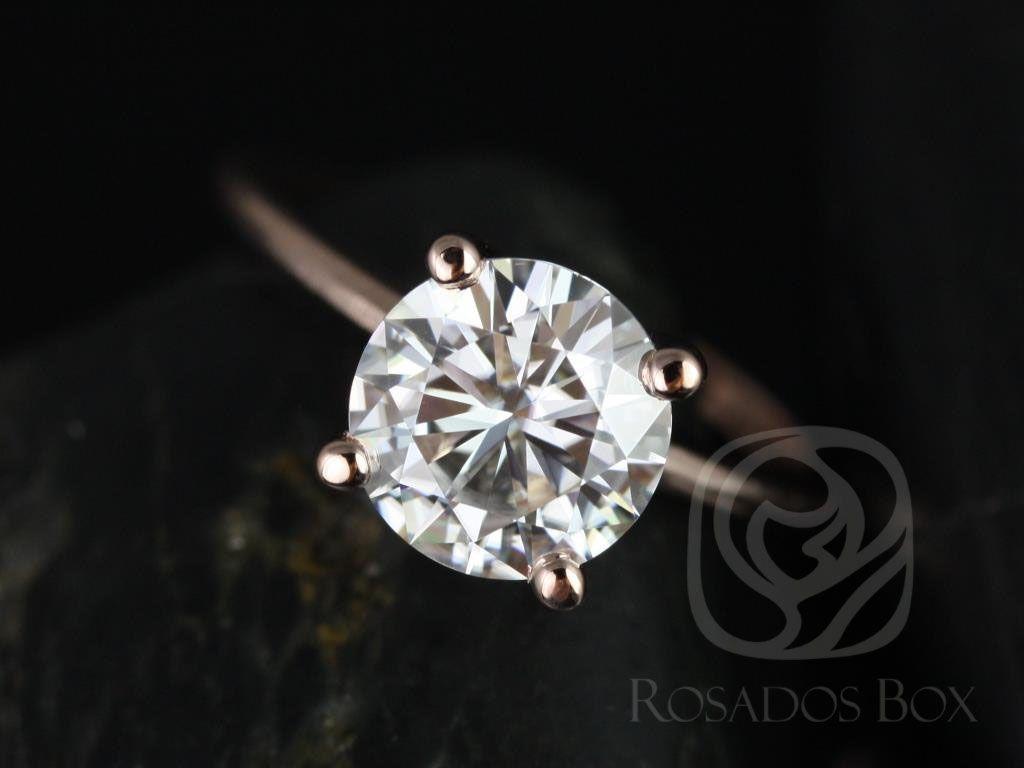 https://www.loveandpromisejewelers.com/media/catalog/product/cache/1b8ff75e92e9e3eb7d814fc024f6d8df/s/k/skinny_alberta_8mm_14kt_rose_gold_round_fb_moissanite_tulip_solitaire_engagement_ring_1_wm.jpg