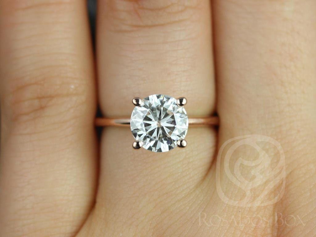 https://www.loveandpromisejewelers.com/media/catalog/product/cache/1b8ff75e92e9e3eb7d814fc024f6d8df/s/k/skinny_alberta_8mm_14kt_rose_gold_round_fb_moissanite_tulip_solitaire_engagement_ring_3_wm.jpg