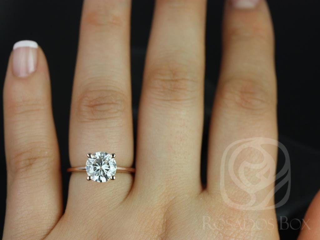 https://www.loveandpromisejewelers.com/media/catalog/product/cache/1b8ff75e92e9e3eb7d814fc024f6d8df/s/k/skinny_alberta_8mm_14kt_rose_gold_round_fb_moissanite_tulip_solitaire_engagement_ring_4_wm.jpg