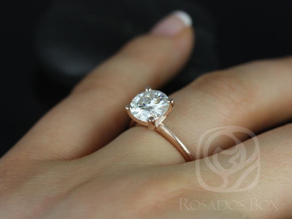 https://www.loveandpromisejewelers.com/media/catalog/product/cache/1b8ff75e92e9e3eb7d814fc024f6d8df/s/k/skinny_alberta_8mm_14kt_rose_gold_round_fb_moissanite_tulip_solitaire_engagement_ring_5_wm.jpg