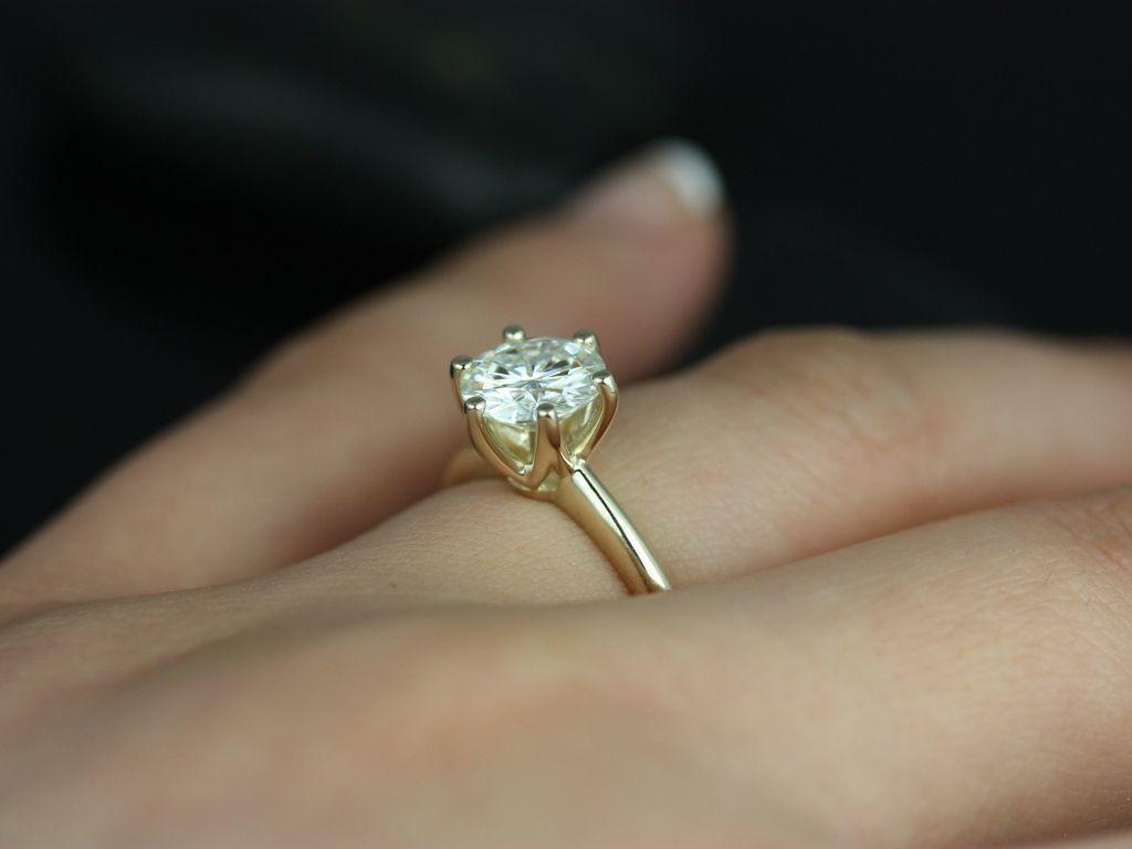 https://www.loveandpromisejewelers.com/media/catalog/product/cache/1b8ff75e92e9e3eb7d814fc024f6d8df/s/k/skinny_webster_fb_moissanite_yellow_gold_engagement_ring_1_.jpg