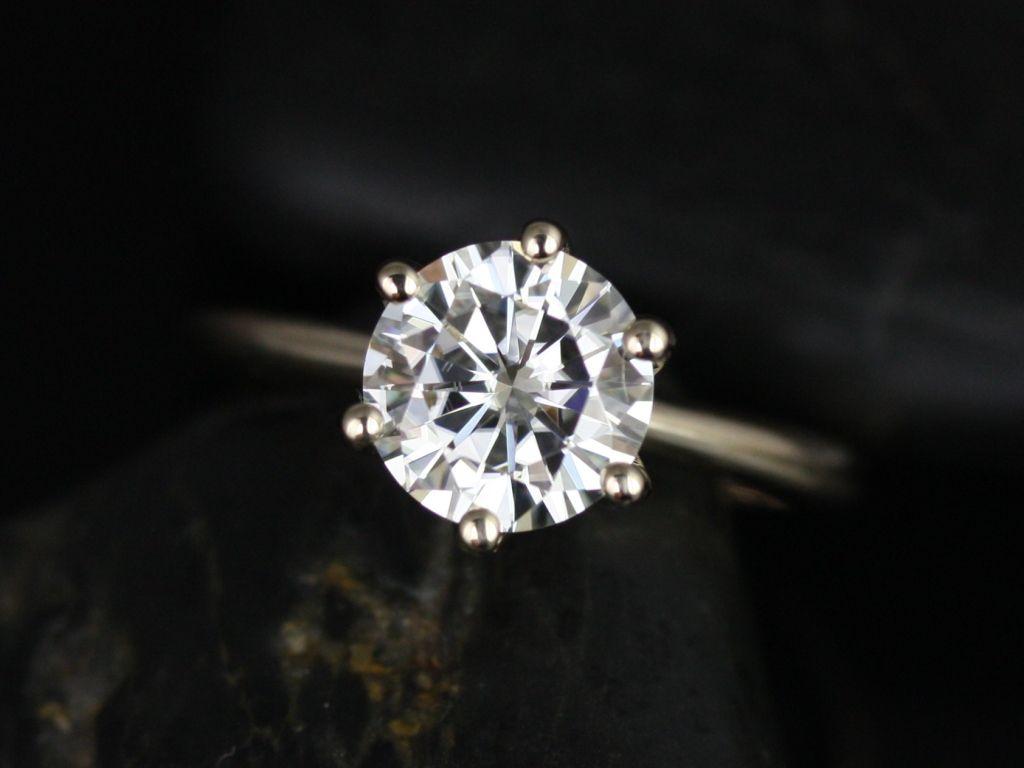 https://www.loveandpromisejewelers.com/media/catalog/product/cache/1b8ff75e92e9e3eb7d814fc024f6d8df/s/k/skinny_webster_fb_moissanite_yellow_gold_engagement_ring_2_.jpg
