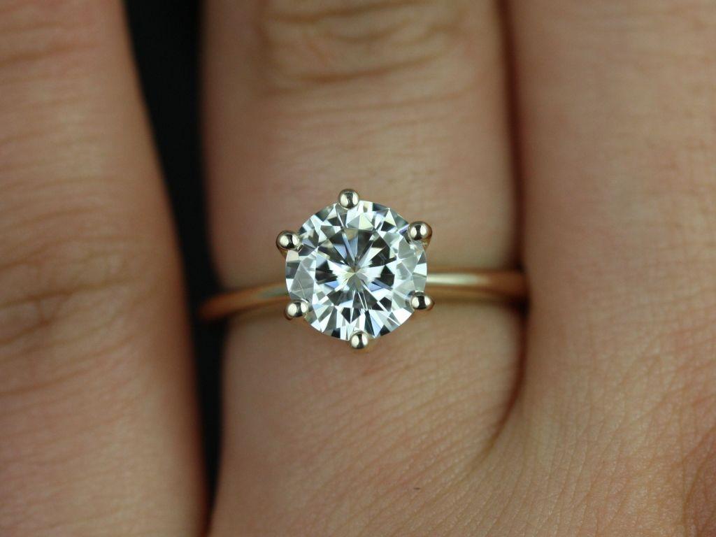 https://www.loveandpromisejewelers.com/media/catalog/product/cache/1b8ff75e92e9e3eb7d814fc024f6d8df/s/k/skinny_webster_fb_moissanite_yellow_gold_engagement_ring_4_.jpg