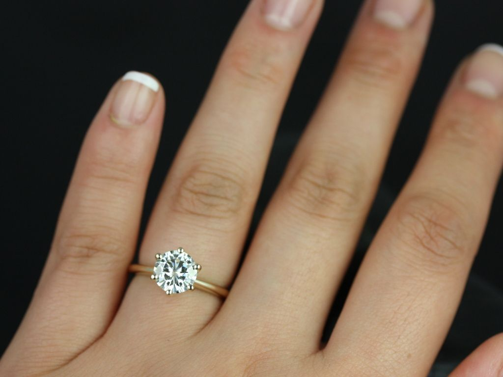 https://www.loveandpromisejewelers.com/media/catalog/product/cache/1b8ff75e92e9e3eb7d814fc024f6d8df/s/k/skinny_webster_fb_moissanite_yellow_gold_engagement_ring_6_.jpg