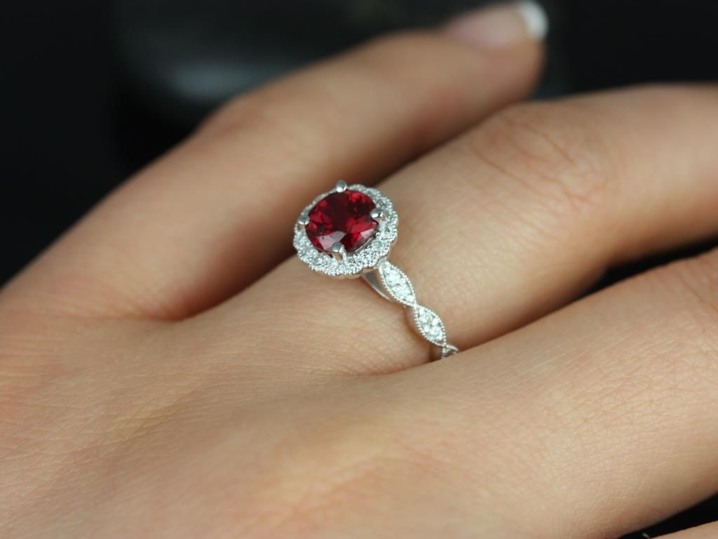 https://www.loveandpromisejewelers.com/media/catalog/product/cache/1b8ff75e92e9e3eb7d814fc024f6d8df/s/u/sunny_14kt_white_gold_crimson_ruby_diamond_flower_halo_with_milgrain_engagement_ring_1_.jpg