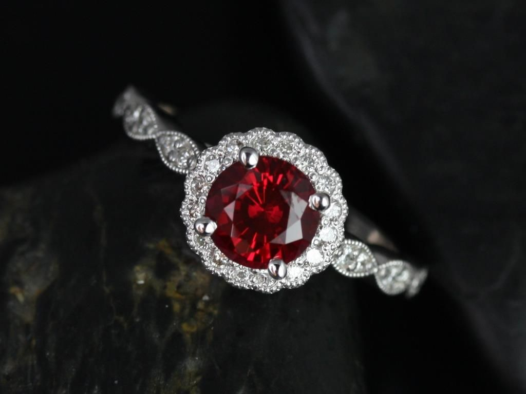 https://www.loveandpromisejewelers.com/media/catalog/product/cache/1b8ff75e92e9e3eb7d814fc024f6d8df/s/u/sunny_14kt_white_gold_crimson_ruby_diamond_flower_halo_with_milgrain_engagement_ring_2_.jpg
