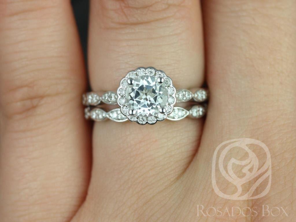 https://www.loveandpromisejewelers.com/media/catalog/product/cache/1b8ff75e92e9e3eb7d814fc024f6d8df/s/u/sunny_6mm_14kt_white_gold_round_white_topaz_and_diamonds_halo_without_milgrain_wedding_set_1wm__1.jpg