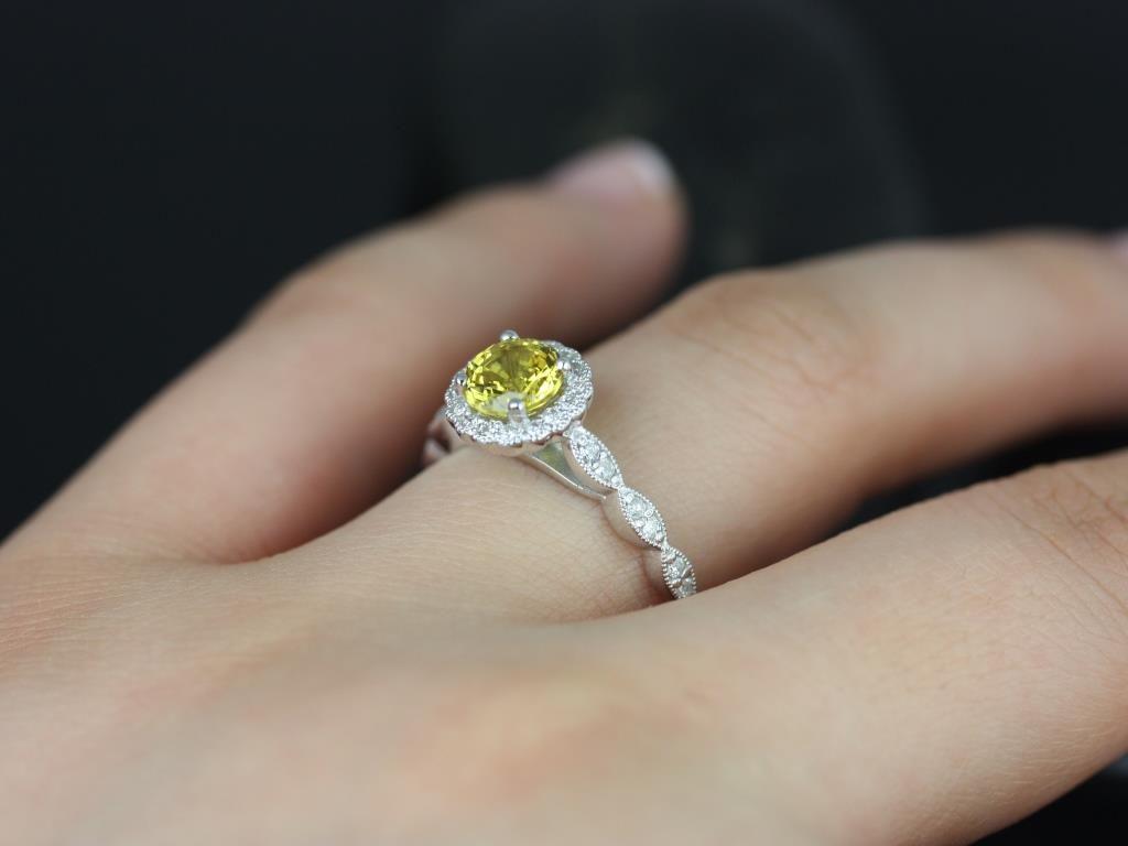 https://www.loveandpromisejewelers.com/media/catalog/product/cache/1b8ff75e92e9e3eb7d814fc024f6d8df/s/u/sunny_lab_yellow_sapphire_with_milgrain_white_gold_engagement_ring_1_.jpg