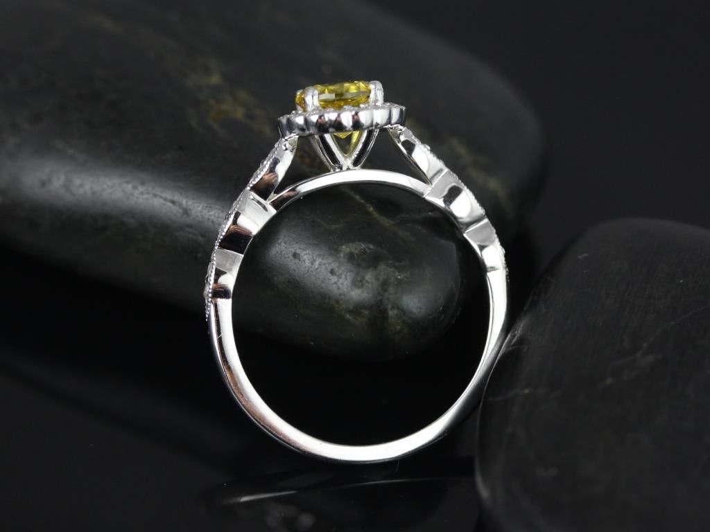 https://www.loveandpromisejewelers.com/media/catalog/product/cache/1b8ff75e92e9e3eb7d814fc024f6d8df/s/u/sunny_lab_yellow_sapphire_with_milgrain_white_gold_engagement_ring_4_.jpg