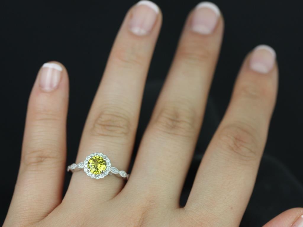 https://www.loveandpromisejewelers.com/media/catalog/product/cache/1b8ff75e92e9e3eb7d814fc024f6d8df/s/u/sunny_lab_yellow_sapphire_with_milgrain_white_gold_engagement_ring_6_.jpg