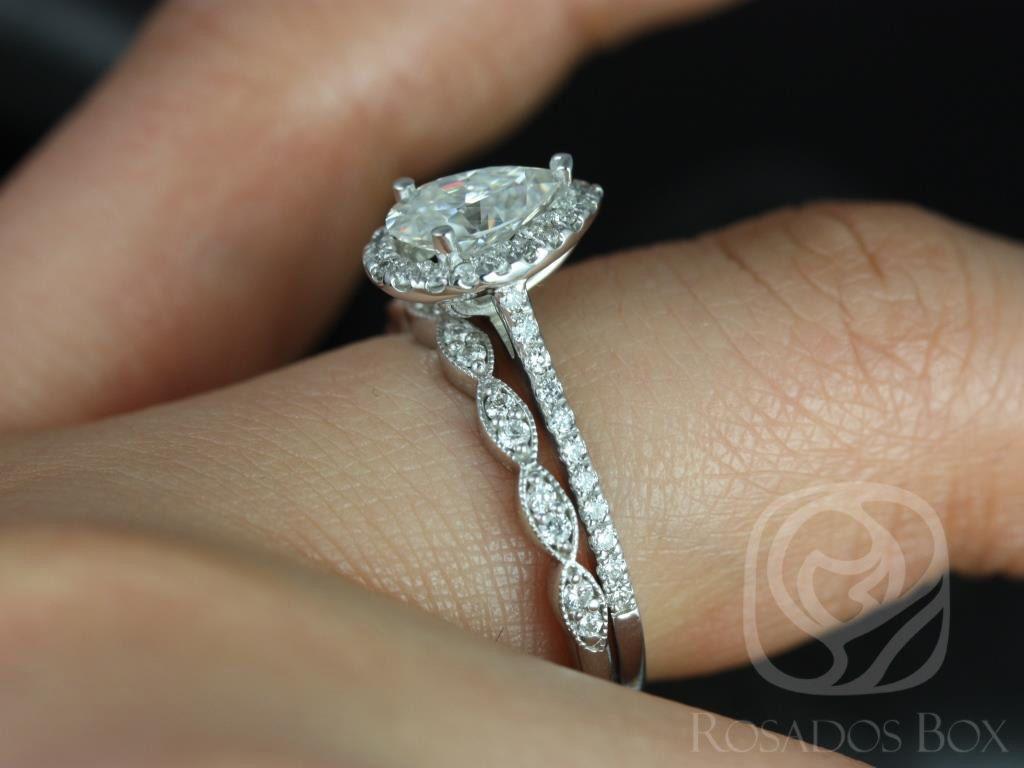 https://www.loveandpromisejewelers.com/media/catalog/product/cache/1b8ff75e92e9e3eb7d814fc024f6d8df/t/a/tabitha_christie_14kt_white_gold_pear_fb_moissanite_and_diamonds_halo_engagement_ring_1wm_.jpg