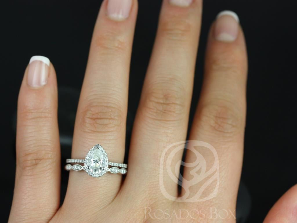 https://www.loveandpromisejewelers.com/media/catalog/product/cache/1b8ff75e92e9e3eb7d814fc024f6d8df/t/a/tabitha_christie_14kt_white_gold_pear_fb_moissanite_and_diamonds_halo_engagement_ring_3wm_.jpg