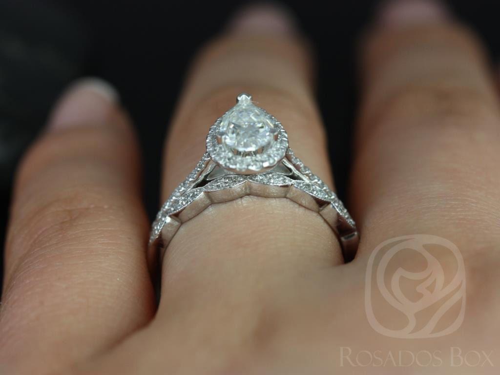 https://www.loveandpromisejewelers.com/media/catalog/product/cache/1b8ff75e92e9e3eb7d814fc024f6d8df/t/a/tabitha_christie_14kt_white_gold_pear_fb_moissanite_and_diamonds_halo_engagement_ring_5wm_.jpg
