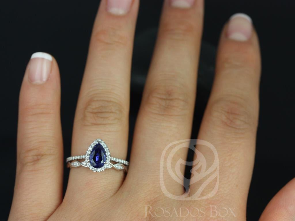 https://www.loveandpromisejewelers.com/media/catalog/product/cache/1b8ff75e92e9e3eb7d814fc024f6d8df/t/a/tabitha_ember_14kt_white_gold_pear_blue_sapphire_and_diamonds_halo_wedding_set_5wm__1.jpg