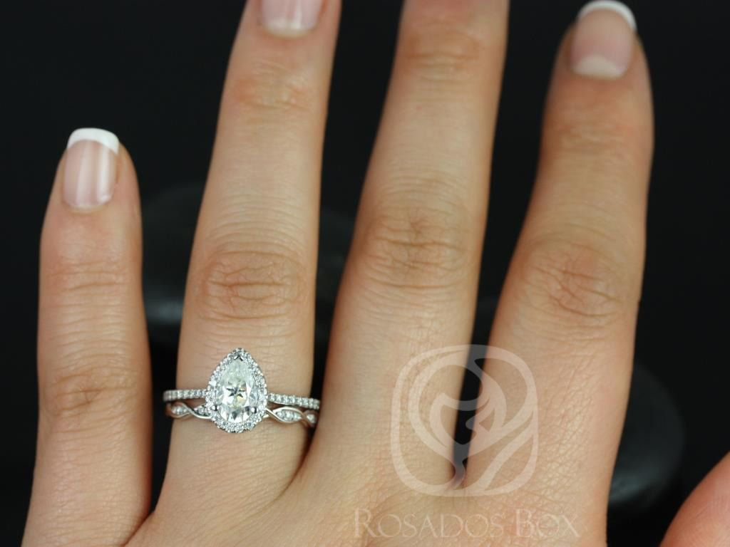 https://www.loveandpromisejewelers.com/media/catalog/product/cache/1b8ff75e92e9e3eb7d814fc024f6d8df/t/a/tabitha_ember_14kt_white_gold_pear_fb_moissanite_and_diamonds_halo_engagement_ring_3wm_.jpg
