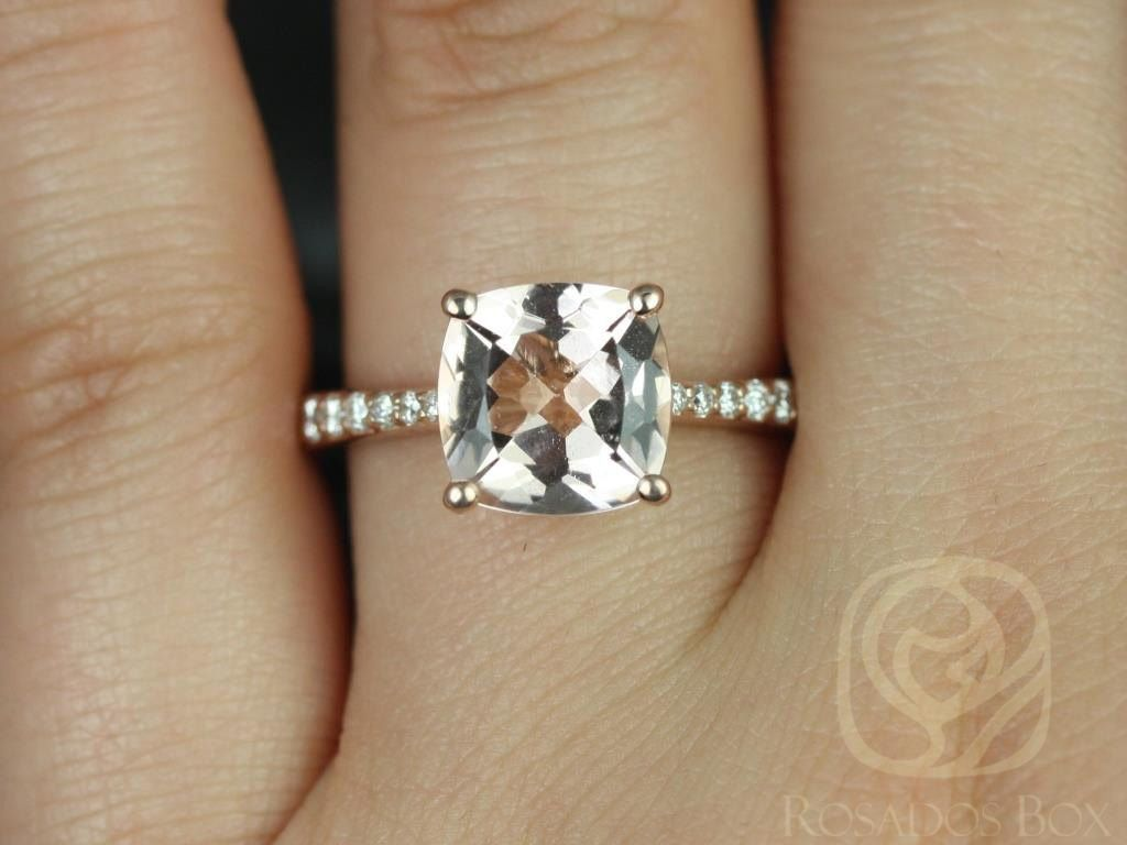 https://www.loveandpromisejewelers.com/media/catalog/product/cache/1b8ff75e92e9e3eb7d814fc024f6d8df/t/a/taylor_9mm_14kt_rose_gold_cushion_morganite_and_diamonds_cathedral_engagement_ring3wm.jpg