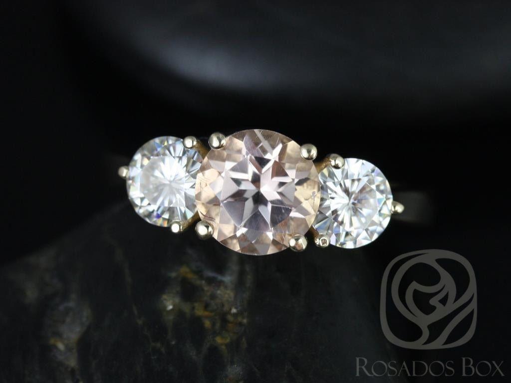https://www.loveandpromisejewelers.com/media/catalog/product/cache/1b8ff75e92e9e3eb7d814fc024f6d8df/t/i/tina_7mm_14kt_yellow_gold_round_morganite_and_fb_moissanite_3_stone_engagement_ring_1wm.jpg
