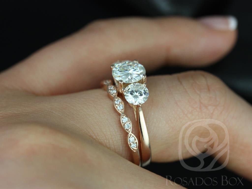 https://www.loveandpromisejewelers.com/media/catalog/product/cache/1b8ff75e92e9e3eb7d814fc024f6d8df/t/i/tina_and_christie_fb_moissanite_diamond_rose_gold_wedding_set_1wm_.jpg