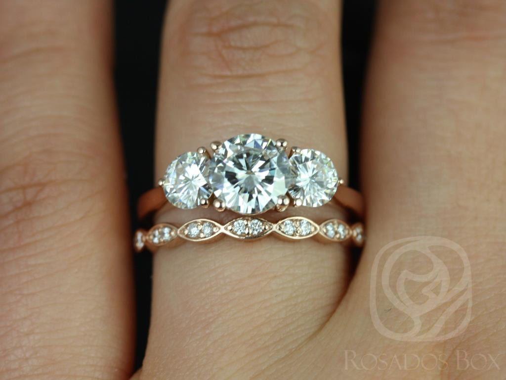 https://www.loveandpromisejewelers.com/media/catalog/product/cache/1b8ff75e92e9e3eb7d814fc024f6d8df/t/i/tina_and_christie_fb_moissanite_diamond_rose_gold_wedding_set_2wm_.jpg