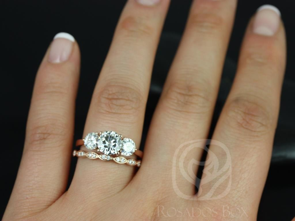 https://www.loveandpromisejewelers.com/media/catalog/product/cache/1b8ff75e92e9e3eb7d814fc024f6d8df/t/i/tina_and_christie_fb_moissanite_diamond_rose_gold_wedding_set_3wm_.jpg