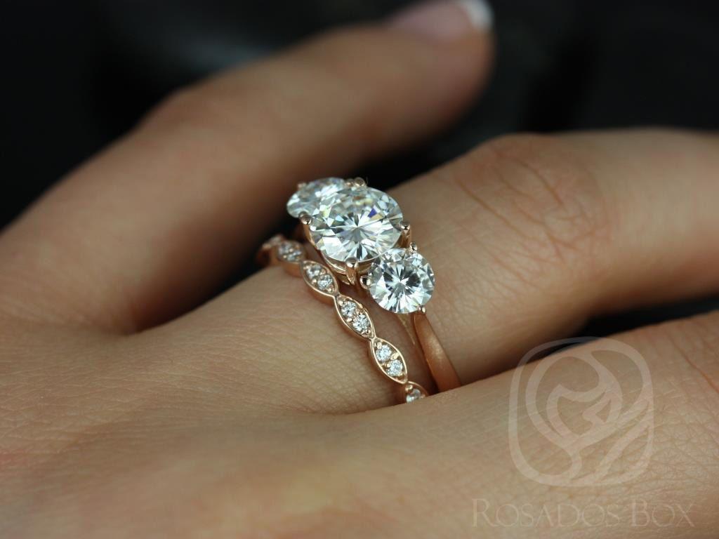 https://www.loveandpromisejewelers.com/media/catalog/product/cache/1b8ff75e92e9e3eb7d814fc024f6d8df/t/i/tina_and_christie_fb_moissanite_diamond_rose_gold_wedding_set_4wm_.jpg
