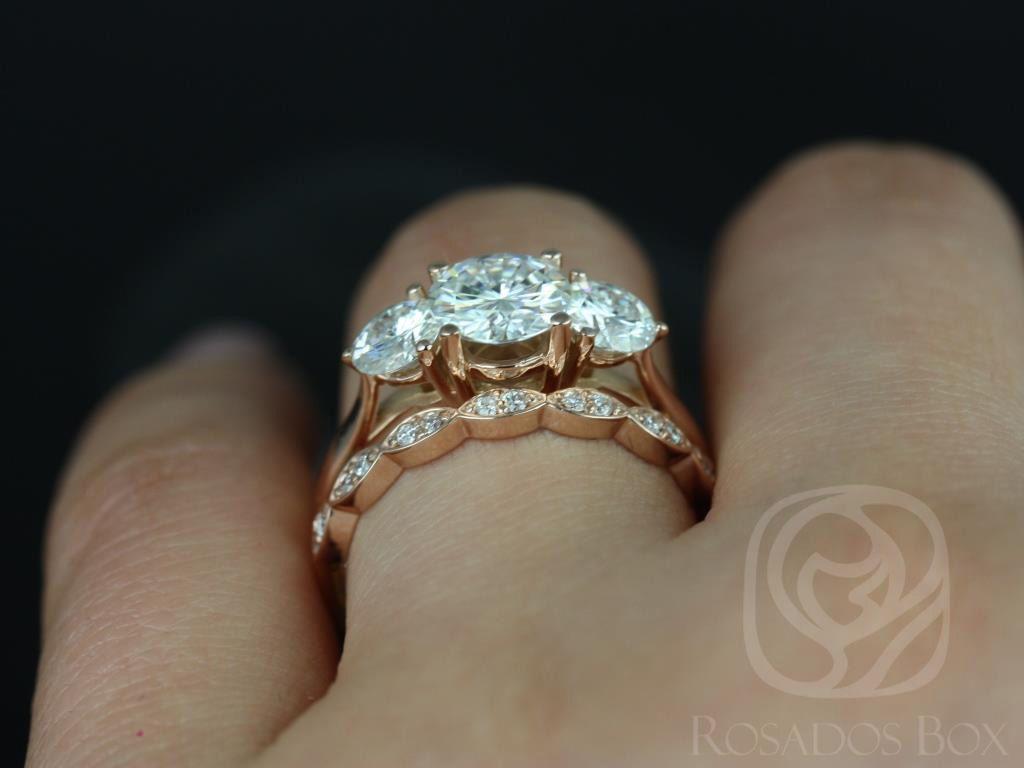 https://www.loveandpromisejewelers.com/media/catalog/product/cache/1b8ff75e92e9e3eb7d814fc024f6d8df/t/i/tina_and_christie_fb_moissanite_diamond_rose_gold_wedding_set_5wm_.jpg