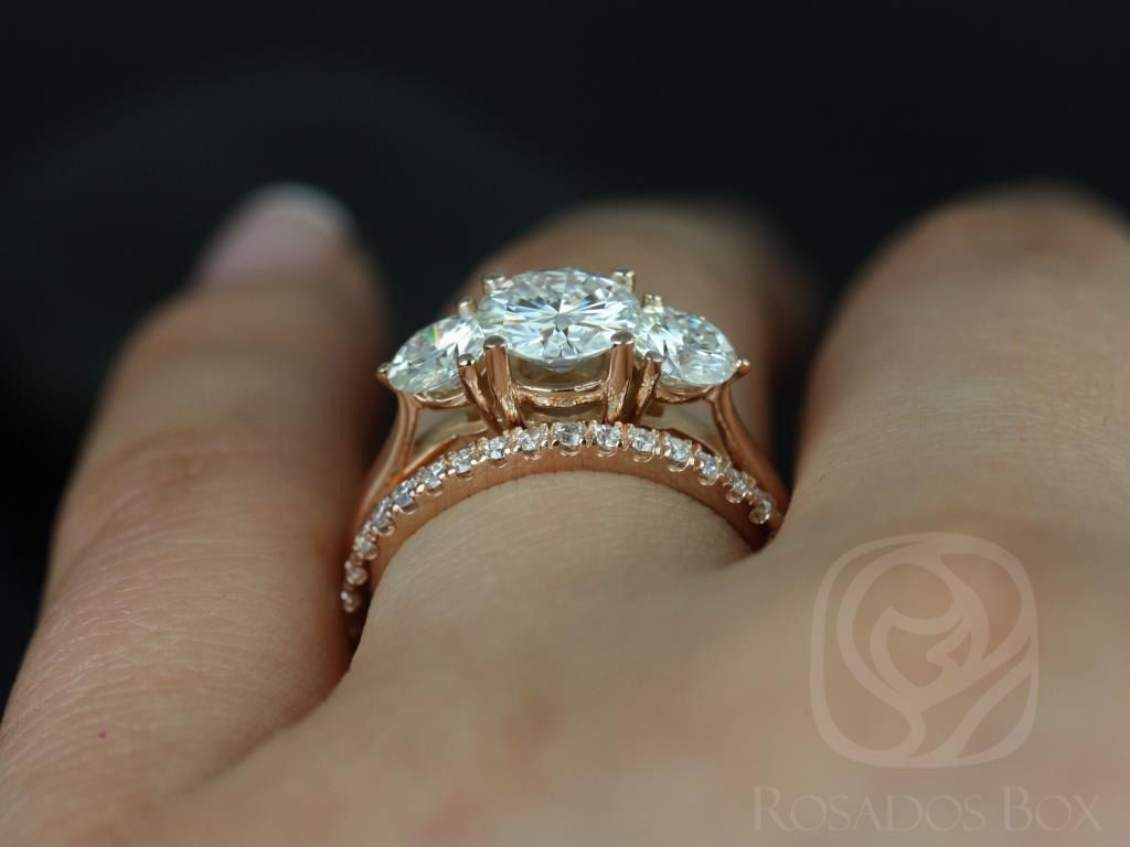 https://www.loveandpromisejewelers.com/media/catalog/product/cache/1b8ff75e92e9e3eb7d814fc024f6d8df/t/i/tina_and_rujira_fb_moissanite_diamond_rose_gold_wedding_set_5wm_.jpg