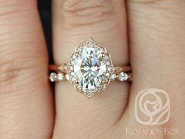 Rosados Box Mae 9x7mm & Cher 14kt Rose Gold Oval F1- Moissanite and Diamond Halo Wedding Set