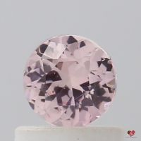 0.64cts Round Warm Peachy Rose Champagne Sapphire