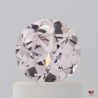 0.61cts Round Icy Peachy Blush Champagne Sapphire
