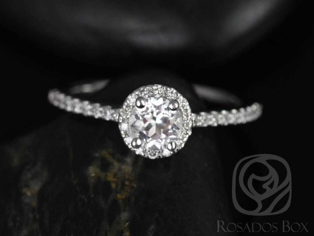https://www.loveandpromisejewelers.com/media/catalog/product/cache/feefdef027ccf0d59dd1fef51db0610e/a/m/amanda_5mm_14kt_white_gold_round_white_topaz_and_diamonds_halo_engagement_ring_1wm.jpg