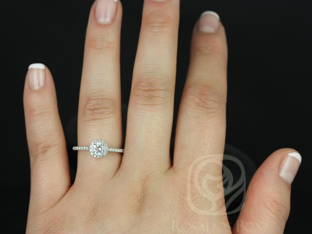 https://www.loveandpromisejewelers.com/media/catalog/product/cache/feefdef027ccf0d59dd1fef51db0610e/a/m/amanda_5mm_14kt_white_gold_round_white_topaz_and_diamonds_halo_engagement_ring_4wm.jpg