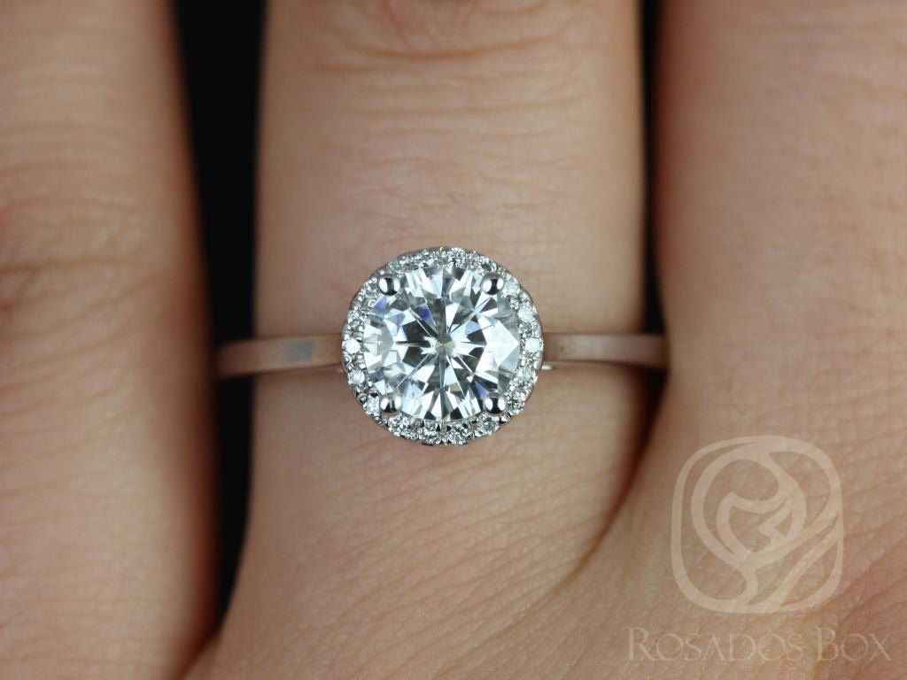 https://www.loveandpromisejewelers.com/media/catalog/product/cache/feefdef027ccf0d59dd1fef51db0610e/a/m/amerie_6.50mm_14kt_white_gold_round_fb_moissanite_and_diamonds_halo_engagement_ring_other_metals_and_stone_options_available_3wm.jpg