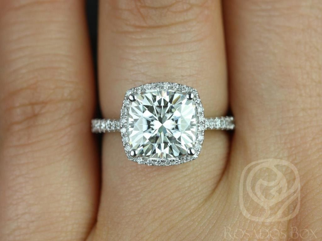 https://www.loveandpromisejewelers.com/media/catalog/product/cache/feefdef027ccf0d59dd1fef51db0610e/b/a/barra_9mm_size_14kt_white_gold_cushion_cut_fb_moissanite_and_diamonds_halo_engagement_ring_other_metals_and_stone_options_available_3wm.jpg