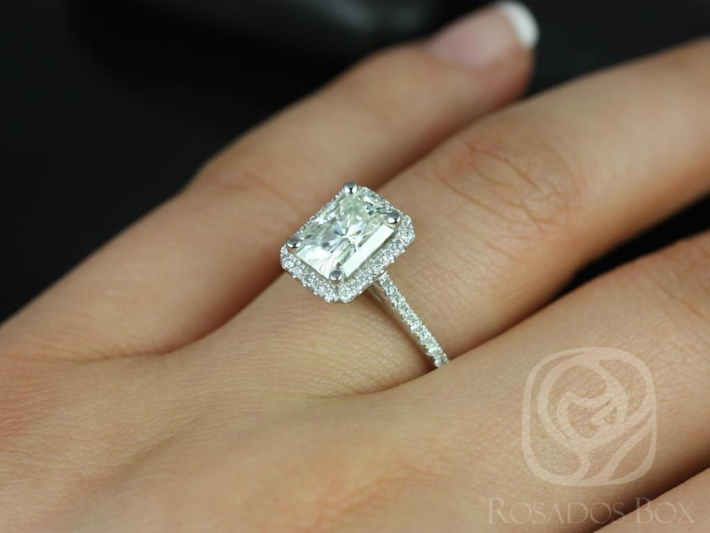 https://www.loveandpromisejewelers.com/media/catalog/product/cache/feefdef027ccf0d59dd1fef51db0610e/b/r/brianna_8x6mm_14kt_white_gold_radiant_fb_moissanite_and_diamonds_halo_engagement_ring_other_center_stone_available_upon_request_5wm.jpg
