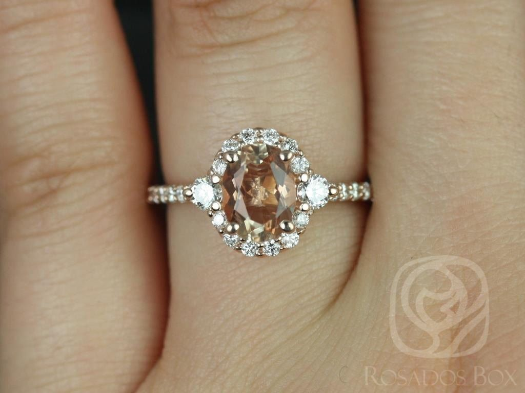 https://www.loveandpromisejewelers.com/media/catalog/product/cache/feefdef027ccf0d59dd1fef51db0610e/b/r/bridgette_8x6mm_14kt_rose_gold_oval_oregon_sunstone_and_diamonds_halo_engagement_ring_other_metals_and_stone_options_available_3wm_1.jpg