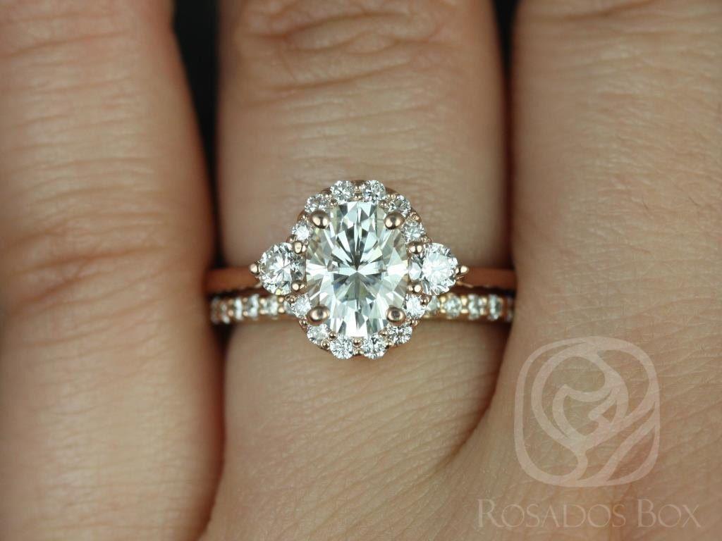 https://www.loveandpromisejewelers.com/media/catalog/product/cache/feefdef027ccf0d59dd1fef51db0610e/b/r/britney_8x6mm_14kt_rose_gold_oval_fb_moissanite_and_diamonds_halo_wedding_set_1wm_.jpg