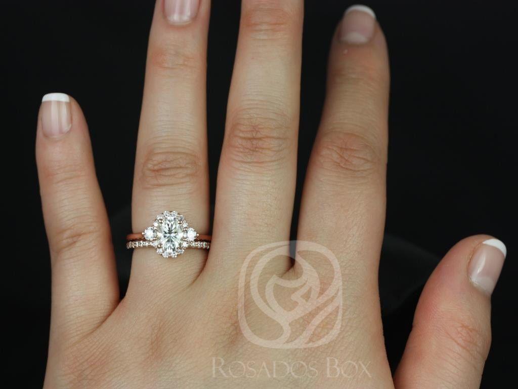 https://www.loveandpromisejewelers.com/media/catalog/product/cache/feefdef027ccf0d59dd1fef51db0610e/b/r/britney_8x6mm_14kt_rose_gold_oval_fb_moissanite_and_diamonds_halo_wedding_set_2wm_.jpg