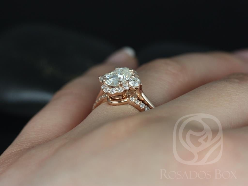 https://www.loveandpromisejewelers.com/media/catalog/product/cache/feefdef027ccf0d59dd1fef51db0610e/b/r/britney_8x6mm_14kt_rose_gold_oval_fb_moissanite_and_diamonds_halo_wedding_set_3wm_.jpg