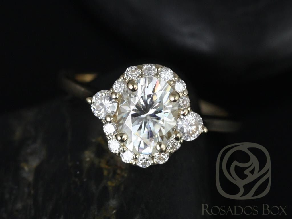 https://www.loveandpromisejewelers.com/media/catalog/product/cache/feefdef027ccf0d59dd1fef51db0610e/b/r/britney_8x6mm_14kt_yellow_gold_oval_fb_moissanite_and_diamonds_halo_engagement_ring_other_metals_and_stone_options_available_1wm.jpg