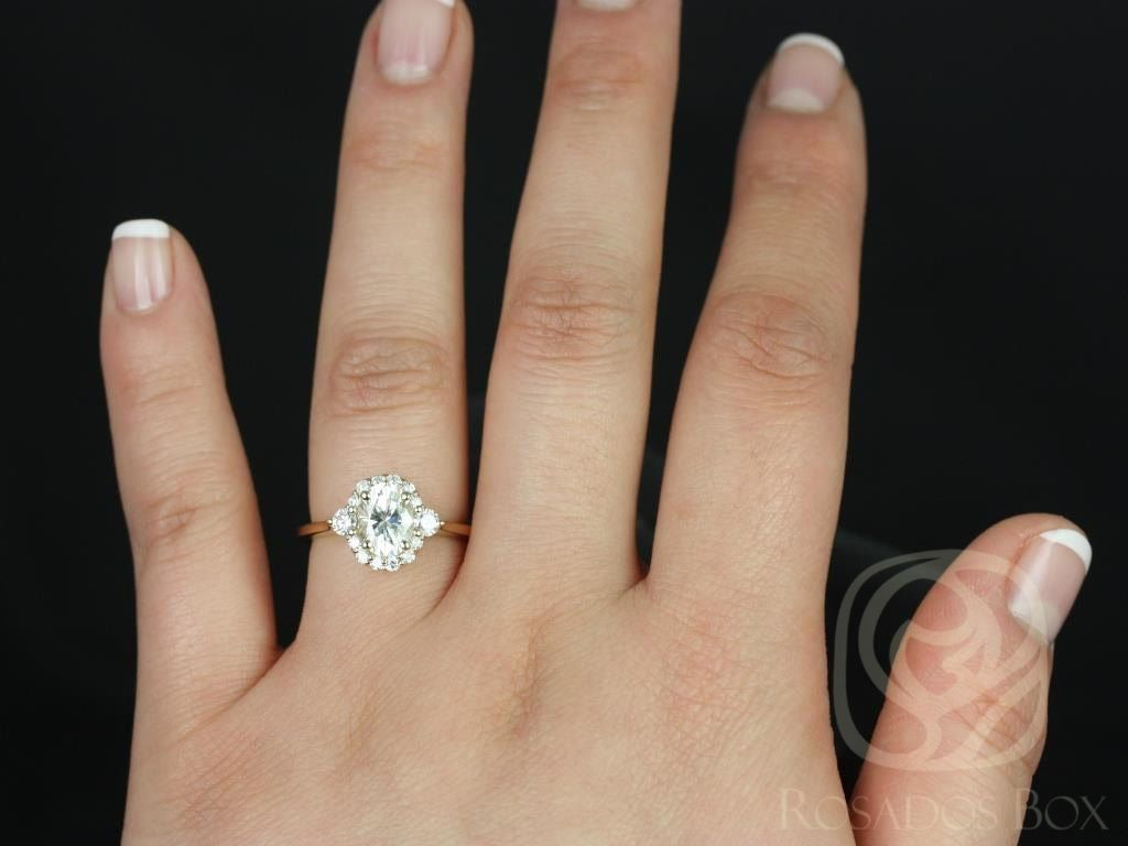 https://www.loveandpromisejewelers.com/media/catalog/product/cache/feefdef027ccf0d59dd1fef51db0610e/b/r/britney_8x6mm_14kt_yellow_gold_oval_fb_moissanite_and_diamonds_halo_engagement_ring_other_metals_and_stone_options_available_4wm.jpg