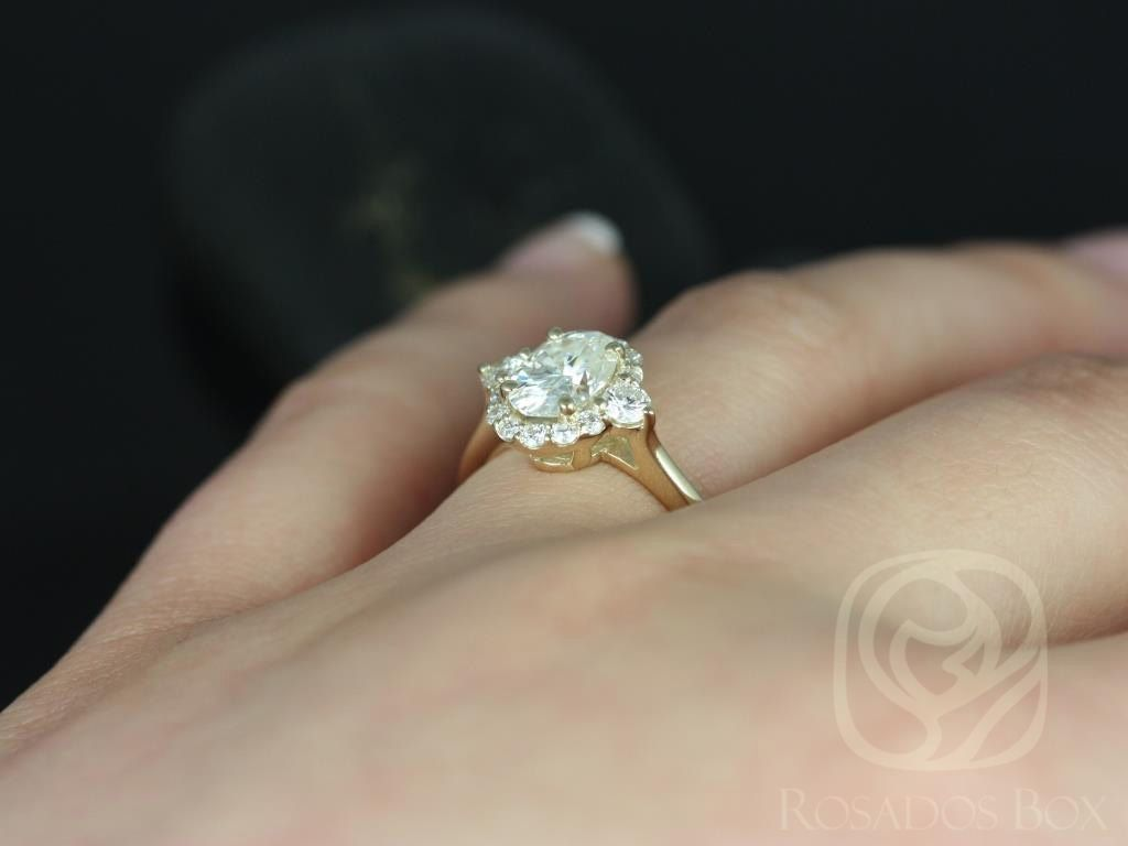 https://www.loveandpromisejewelers.com/media/catalog/product/cache/feefdef027ccf0d59dd1fef51db0610e/b/r/britney_8x6mm_14kt_yellow_gold_oval_fb_moissanite_and_diamonds_halo_engagement_ring_other_metals_and_stone_options_available_5wm.jpg