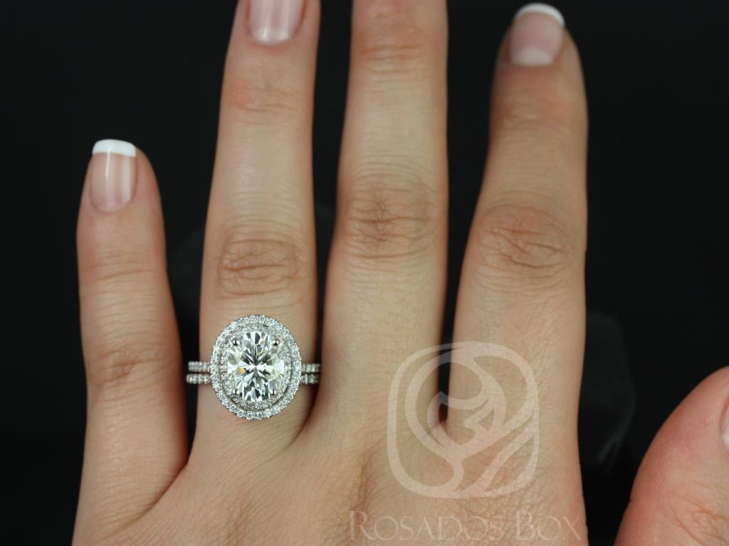 https://www.loveandpromisejewelers.com/media/catalog/product/cache/feefdef027ccf0d59dd1fef51db0610e/c/a/cara_10x8mm_14kt_white_gold_oval_fb_moissanite_and_diamonds_double_halo_classic_wedding_set_3wm_.jpg